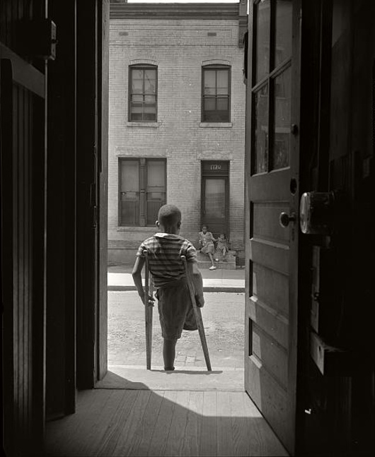 Young Boy Standing in the Doorway of his Home by Gordon Parks, 1942